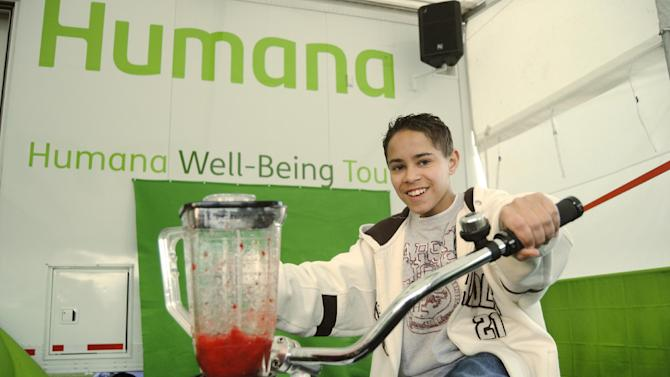 """IMAGE DISTRIBUTED FOR HUMANA- A child uses """"pedal power"""" to create a fresh fruit smoothie at the Humana Well-Being Tour during the Humana Challenge First Tee Master Class on Monday, January 14, at PGA West in La Quinta, Calif. The First Tee Master Class gave approximately 40 local children a behind-the scenes look at the 2013 Humana Challenge, including tours of the media center, Bob Hope Square and the Humana Well-Being Tour, as well as the chance to participate in a drill on the driving range. The 2013 Humana Challenge PGA TOUR golf tournament is being held Jan. 14-20, 2013, in La Quinta, Calif.  (Carlos Puma / AP Images for Humana)"""