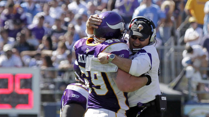 Minnesota Vikings defensive end Jared Allen celebrates with offensive line coach Jeff Davidson after an interception during the second half of a NFL football game Sunday, Sept. 11, 2011, in San Diego.  (AP Photo/Gregory Bull)