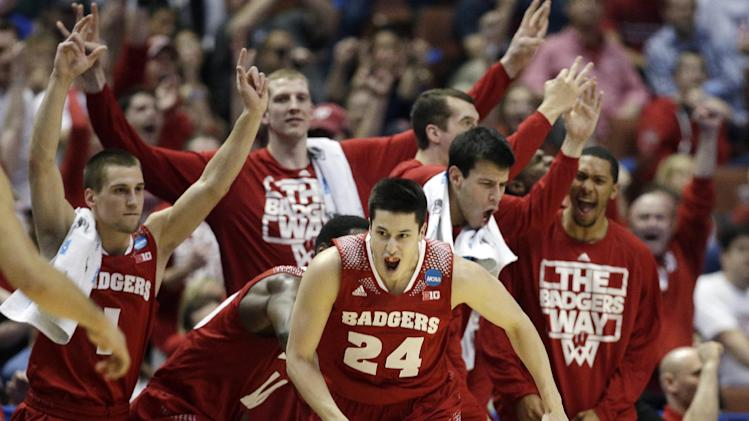 Wisconsin 's Bronson Koenig (24) reacts after making a three-point basket during the second half in a regional final NCAA college basketball tournament game against Arizona, Saturday, March 29, 2014, in Anaheim, Calif. (AP Photo/Jae C. Hong)