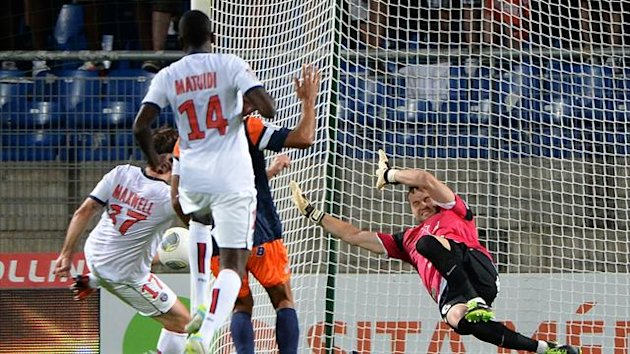 Paris Saint-Germain's Brazilian defender Maxwell (L) scores a goal against Montpellier's French goalkeeper Geoffrey Jourdren (AFP)