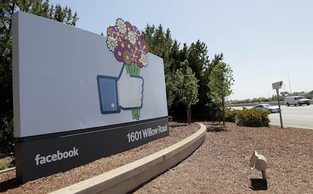 This May 11, 2012, photo shows a sign is shown at the Facebook campus in Menlo Park, Calif. Half of Americans think Facebook is a passing fad, according to the results of an Associated Press-CNBC poll. And, in the run-up to the social network&#39;s initial public offering of stock, half of Americans also say the social network&#39;s asking price is too high. (AP Photo/Jeff Chiu)