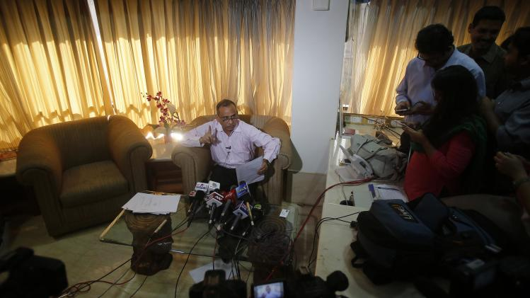 Uttam Khobragade, father of Devyani Khobragade, India's deputy consul general in New York, speaks during a news conference in Mumbai