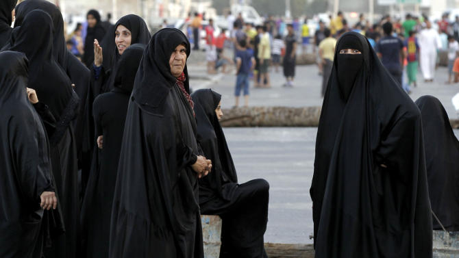 Bahraini anti-government protesters return to the streets after being dispersed by riot police firing tear gas resume their demonstration in Malkiya, Bahrain, Thursday, Nov. 8, 2012. (AP Photo/Hasan Jamali