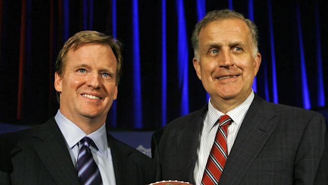 FILE - In this Aug. 8, 2012, Roger Goodell, left, the NFL's chief operating officer, and Paul Tagliabue, NFL commissioner, pose for photos after Goodell was selected to succeed Tagliabue as the league's new commissioner at an NFL meeting in Northbrook, Ill. Goodell appointed Tagliabue on Friday, Oct. 19, 2012, to hear the appeals of four players suspended in the New Orleans Saints bounties scandal.(AP Photo/M. Spencer Green, File)