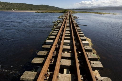 <p>File picture shows a section of railway line at Swartvlei Lagoon close to Knysna, South Africa. More than 30 people were on Friday killed in South Africa when a train ploughed into a truck carrying dozens of farm workers on a railway line, an official said.</p>