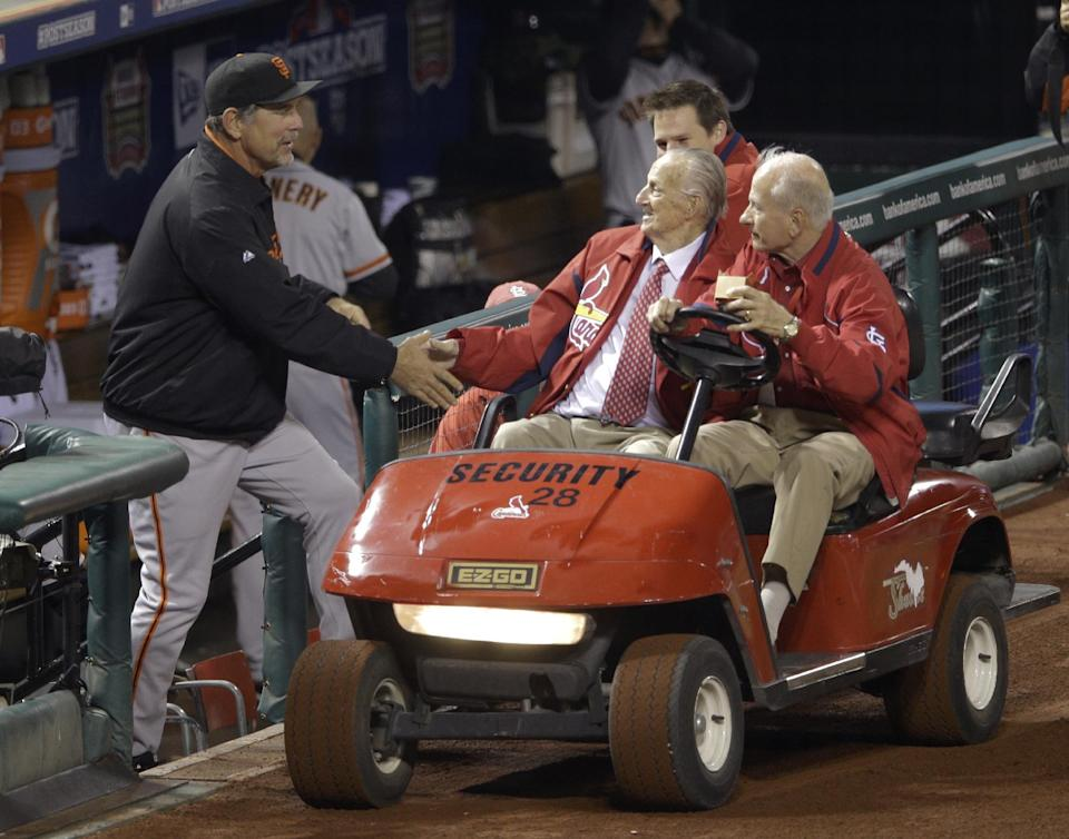 San Francisco Giants manager Bruce Bochy shakes hands with Stan Musial before Game 4 of baseball's National League championship series against the St. Louis Cardinals Thursday, Oct. 18, 2012, in St. Louis. (AP Photo/Patrick Semansky)