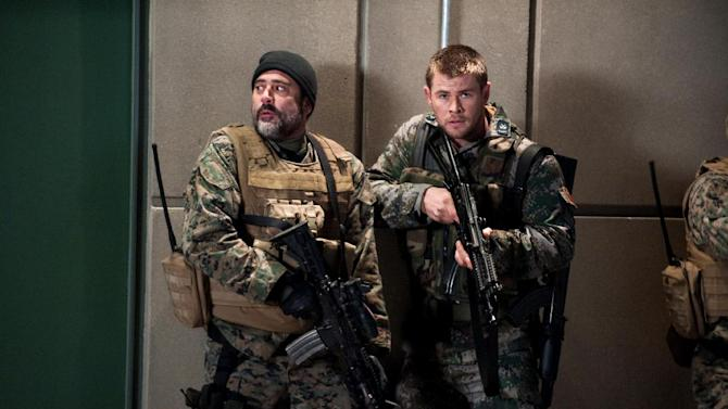 "This film image released by Film District shows Jeffrey Dean Morgan, left, and Chris Hemsworth in a scene from ""Red Dawn."" (AP Photo/Film District)"
