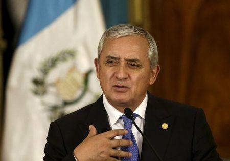 Guatemala's president quits, faces charges in graft scandal