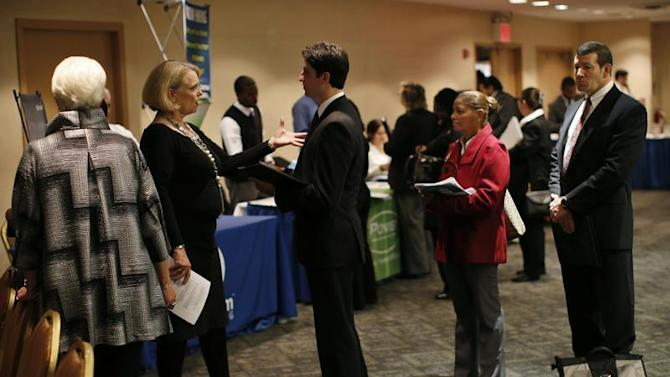 Job seekers wait to meet with employers at a career fair in New York City