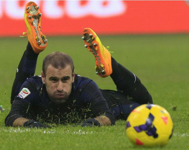 Inter Milan's Palacio looks at the ball during their Italian Serie A soccer match against Parma at the San Siro stadium in Milan