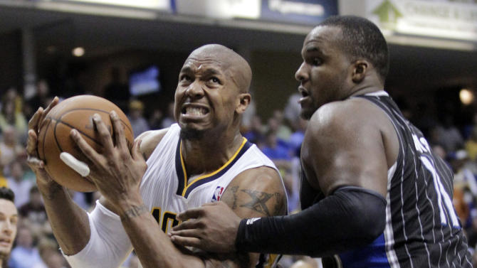 Orlando Magic forward Glen Davis, right, fouls Indiana Pacers forward David West during the second half of Game 5 of an NBA basketball first-round playoff series, in Indianapolis on Tuesday, May 8, 2012. The Pacers defeated the Magic 105-87 to win the series 4-1. (AP Photo/Michael Conroy)