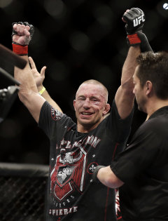 Georges St-Pierre celebrates his win. (AP)