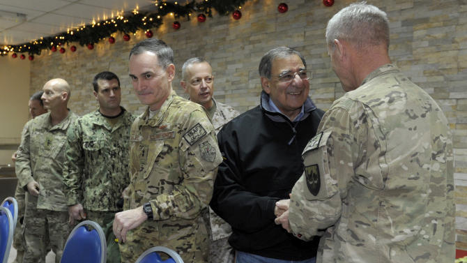 Defense Secretary Leon Panetta, second from right, meets with commanders, including Marine Gen. John R. Allen, commander of International Security Assistance Force, third from right, before a dinner with them at International Security Assistance Force headquarters in Kabul, Afghanistan, Wednesday, Dec. 12, 2012. (AP Photo/Susan Walsh, Pool)