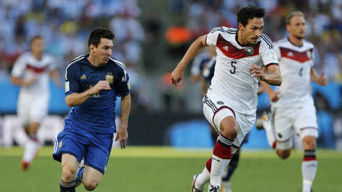 Argentina's Lionel Messi, left, and Germany's Mats Hummels go downfield during the World Cup final soccer match between Germany and Argentina at the Maracana Stadium in Rio de Janeiro, Brazil, Sunday, July 13, 2014. (AP Photo/Frank Augstein)