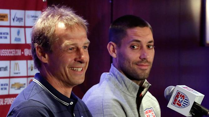 U.S. men's soccer coach Jurgen Klinsmann, left, and World Cup team captain Clint Dempsey answer questions during a news conference, in New York, Friday, May 30, 2014. The U.S. World Cup team is holding a pep rally in Times Square leading to Sunday's exhibition against Turkey, the second of three warmup matches for the Americans before next month's tournament in Brazil