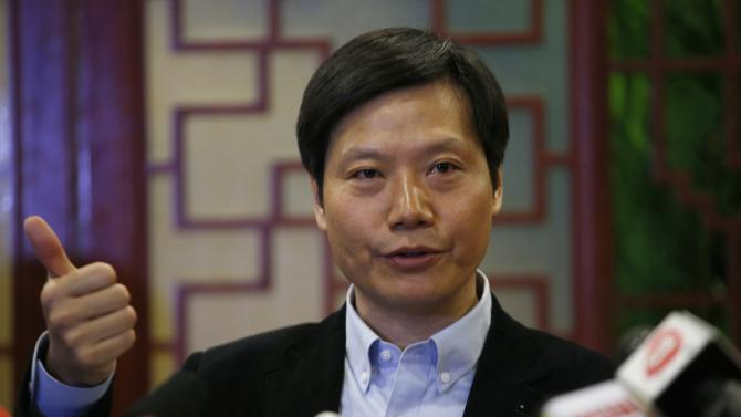 Lei Jun, founder and chief executive officer of China's mobile company Xiaomi Inc, gestures at a news conference which was held as part of the National People's Congress in Beijing