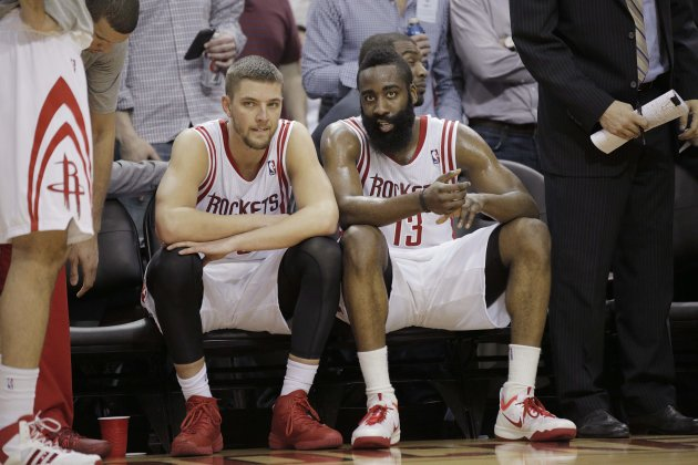 Mar 9, 2014; Houston, TX, USA; Houston Rockets small forward Chandler Parsons (25) and shooting guard James Harden (13) sit on the bench during the fo...