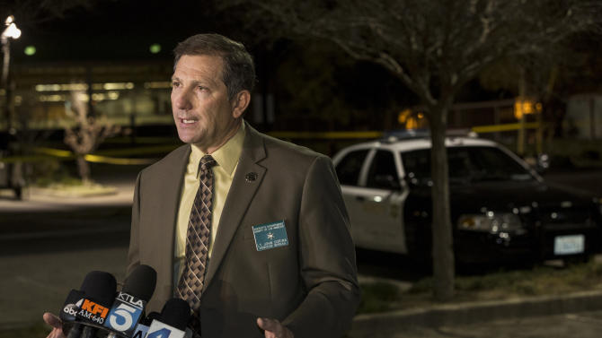 """Los Angeles County Sheriff's Department Lt. John Corina speaks at a news brief at the scene of an accident in a parking lot in Compton, Calif., Thursday, Jan. 29, 2015. A lawyer for Marion """"Suge"""" Knight, a Death Row Records founder, says Knight was driving a vehicle involved in an accident. (AP Photo/Damian Dovarganes)"""
