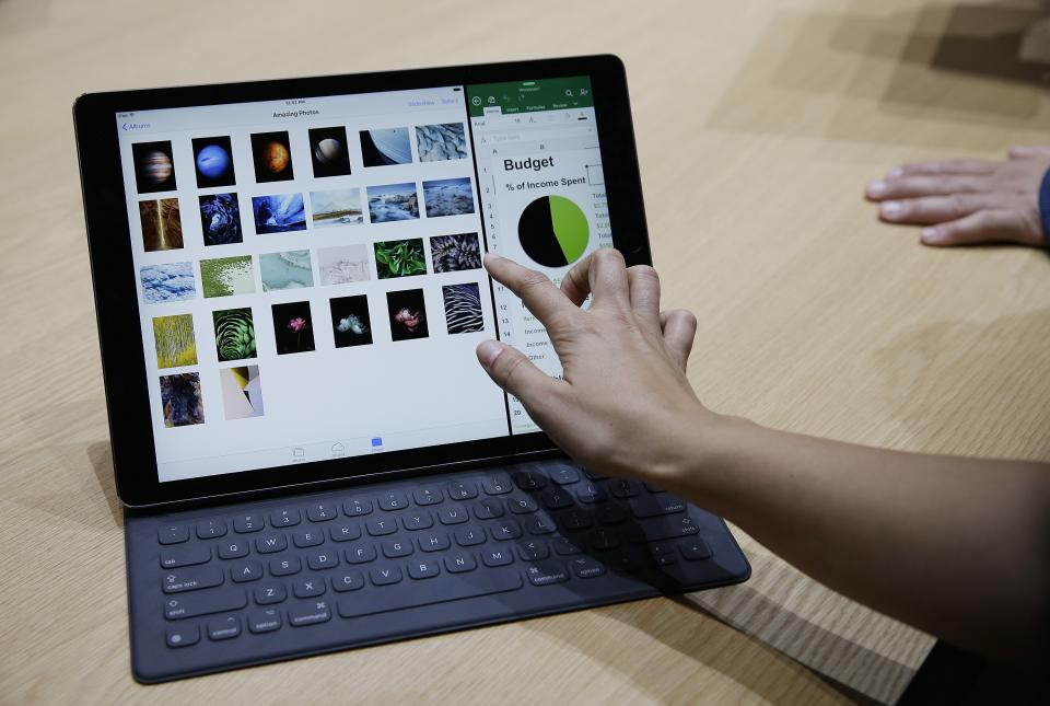 FILE - In this Sept. 9, 2015 file photo, the new iPad Pro with a Smart Keyboard is displayed following an Apple event  in San Francisco. Designed with...