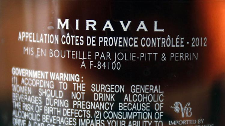 The names of Brad Pitt and Angelina Jolie are visible on a bottle of Miraval, Cote de Provence rose wine displayed in Paris, Thursday March 7, 2013. The first wine to be sold from a French vineyard owned by Hollywood couple Brad Pitt and Angelina Jolie goes on offer today to online buyers.(AP Photo/Remy de la Mauviniere)
