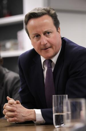 British Prime Minister David Cameron meets with social entrepreneurs at the Brigade as part of his launch of Big Society Capital, London, Wednesday, April 4, 2012. (AP Photo/Sang Tan, Pool)
