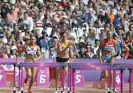 (From left) Britain&#39;s Jessica Ennis, Belgium&#39;s Sara Aerts and Russia&#39;s Tatyana Chernova compete in the women&#39;s heptathlon 100m hurdles heats at the athletics event during the London 2012 Olympic Games. Ennis made a flying start to the heptathlon as the London Games athletics programme got under way in front of a vocal, 80,000-capacity Olympic Stadium crowd