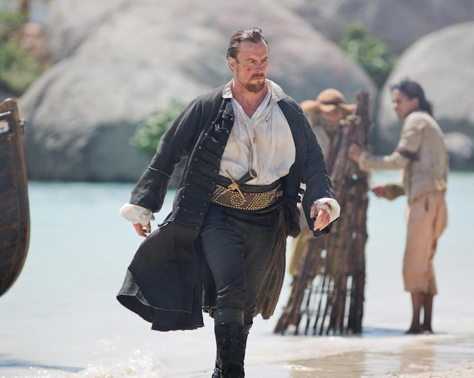 "This publicity photo provided by Starz Entertainment, LLC shows, from left, Toby Stephens as Captain Flint, in a scene from ""Black Sails."" (AP Photo/Copyright Starz Entertainment, LLC, Keith Bernstein)"