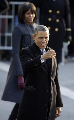 President Barack Obama and first lady Michelle Obama walk down Pennsylvania Avenue en route to the White House, Monday, Jan. 21, 2013, in Washington. Thousands  marched during the 57th Presidential Inauguration parade after the ceremonial swearing-in of President Barack Obama. (AP Photo/Steve Helber)