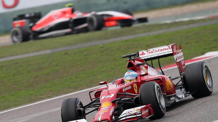 Ferrari driver Fernando Alonso of Spain, bottom, drives during the Chinese Formula One Grand Prix at Shanghai International Circuit in Shanghai, Sunday, April 20, 2014. (AP Photo/Eugene Hoshiko)