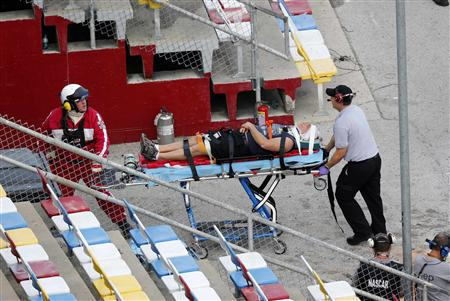 Rescue workers attend to an injured person in the stands following a last-lap incident during the NASCAR Nationwide Series DRIVE4COPD 300 race at the Daytona International Speedway in Daytona Beach