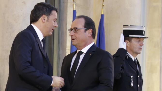 French President Hollande welcomes Italian Prime Minister Renzi as he arrives at the Elysee Palace in Paris