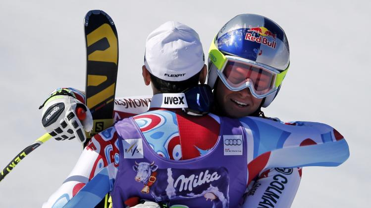 Winner Pinturault of France hugs second placed compatriot Blondin Mermillod after competing in the men's Super G competition during the FIS Alpine Skiing World Cup finals in the Swiss ski resort of Lenzerheide