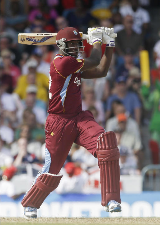 West Indies' Andre Russell plays a shot against England during their first T20 International cricket match at the Kensington Oval in Bridgetown, Barbados, Sunday, March 9, 2014. (AP Photo/Ricardo