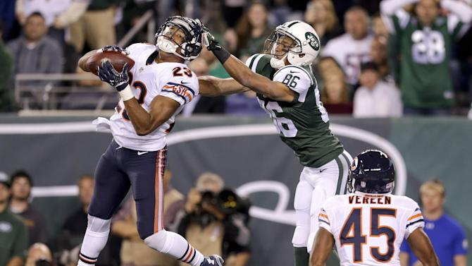 Chicago Bears cornerback Kyle Fuller (23) intercepts a pass in the end zone intended for New York Jets wide receiver David Nelson (86) in the third quarter of an NFL football game, Monday, Sept. 22, 2014, in East Rutherford, N.J