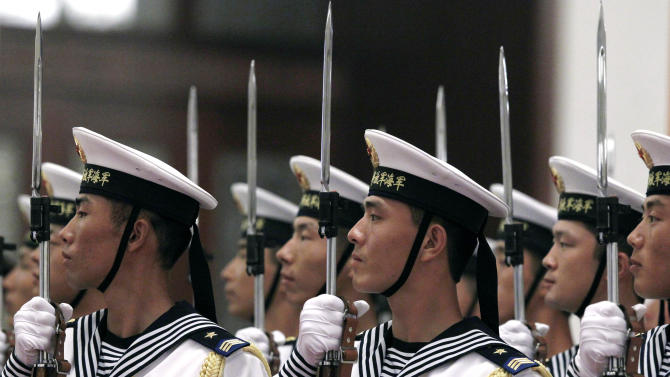 A guard of honor rehearses before the arrival of German Chancellor Angela Merkel outside the Great Hall of the People in Beijing Thursday, Aug. 30, 2012. (AP Photo/Ng Han Guan)