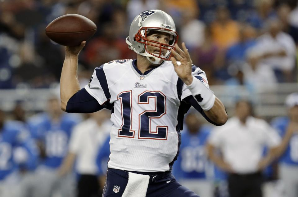 New England Patriots quarterback Tom Brady (12) throws in the first quarter of an NFL preseason football game against the Detroit Lions in Detroit, Thursday, Aug. 22, 2013. (AP Photo/Paul Sancya)