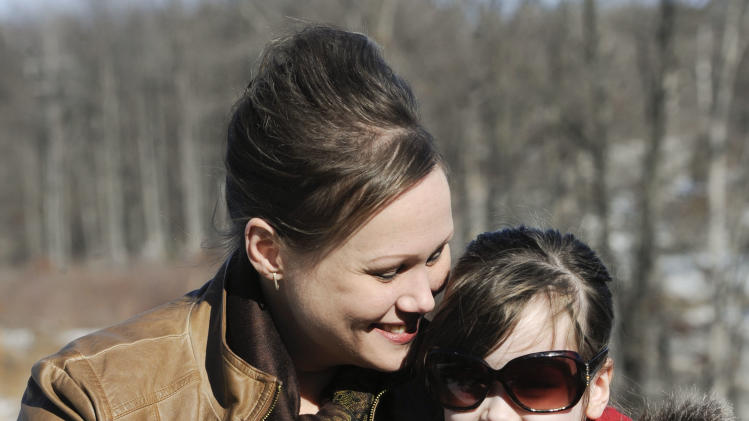 "In this Feb. 10, 2013 photo, Kelly Guarna and her 5-year-old daughter Madison pose for a portrait in Mount Carmel, Pa. The kindergartener was suspended from school for making a ""terroristic threat"" last month after her mother said she talked about shooting a Hello Kitty bubble gun. (AP Photo/Jimmy May)"