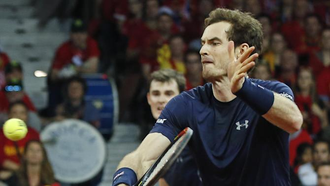 Britain's Andy Murray, foreground, and his brother Jamie Murray, rear, return against Belgium's Steve Darcis and David Goffin during their doubles Davis Cup final tennis match at the Flanders Expo in Ghent, Belgium, Saturday, Nov. 28, 2015. (AP Photo/Alastair Grant)