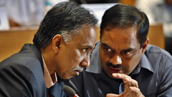 Infosys Technologies Ltd. Chief Executive Officer S.D. Shibulal, left, talks to Chief Financial Officer V. Balakrishnan after announcing company's quarterly financial results at their headquarters in Bangalore, India, Thursday, Jan. 12, 2012. Quarterly profits at Infosys beat expectations, but the outsourcing bellwether said Thursday that the global economic slowdown and chaos in Europe would hit growth going forward, disappointing investors. (AP Photo/Aijaz Rahi)