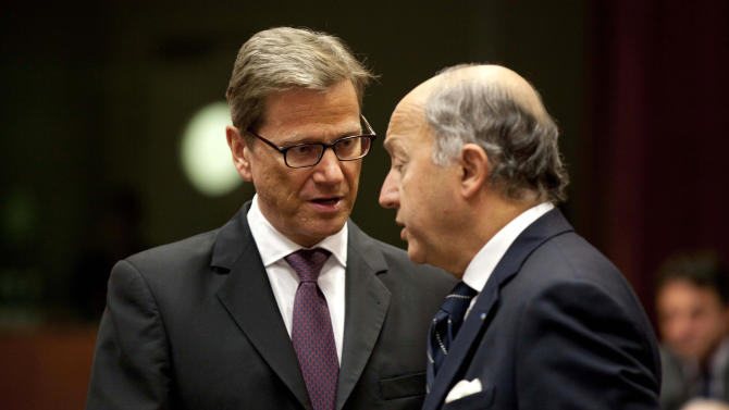 German Foreign Minister Guido Westerwelle, left, speaks with French Foreign Minister Laurent Fabius during an emergency meeting of EU foreign ministers at the EU Council building in Brussels on Thursday, Jan. 17, 2013. A former French colony, Mali once enjoyed a reputation as one of West Africa's most stable democracies with the majority of its 15 million people practicing a moderate form of Islam. That changed in April 2012, when Islamist extremists took over the main cities in the country's north amid disarray following a military coup, and began enforcing their version of strict Shariah law. (AP Photo/Virginia Mayo)