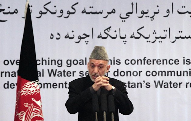 "Afghan President Hamid Karzai gestures, as he speaks during a conference about water management in Kabul, Afghanistan, Tuesday, Jan. 29, 2013. Hamid Karzai. Karzai spoke Tuesday at a conference about water management, where he first talked about the need for clean water systems and then broke off to address what he described as a ""very important issue"" -- the varied attempts at peace talks with the Taliban -- warning against peace talks with the Taliban without the Afghan government's involvement. (AP Photo/Ahmad Jamshid)"
