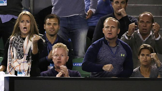 Kim Sears, fiancee of Andy Murray of Britain,  left,  and  coach Amelie Mauresmo, right,  with his team,  watch his men's singles final against Novak Djokovic of Serbia at the Australian Open tennis championship in Melbourne, Australia, Sunday, Feb. 1, 2015. (AP Photo/Vincent Thian)