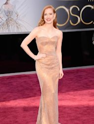 Jessica Chastain arrives at the Oscars in a custom Giorgio Armani copper-toned silk satin strapless gown at Hollywood & Highland Center on February 24, 2013 in Hollywood, Calif. -- Getty Premium