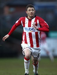 Jamie Cureton scored late on as Exeter beat Gillingham