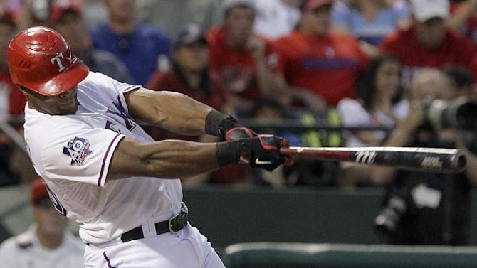 Texas Rangers' Adrian Beltre follows through on hitting a home run during the fourth inning of a baseball game against the Baltimore Orioles, Wednesday, Aug. 22, 2012, in Arlington, Texas. (AP Photo/LM Otero)