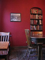 An unusually shaped built-in is perfect for displaying your favorite books.   Source:  Flickr User…