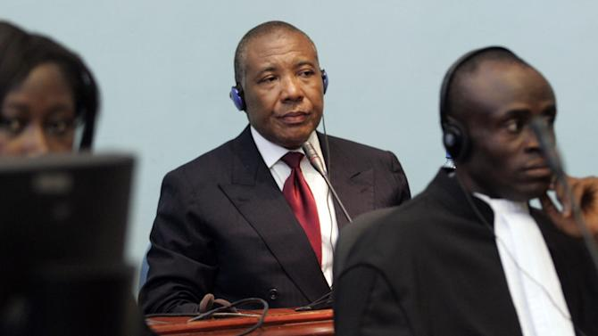 FILE - In this April 3, 2006 file photo, former Liberian President Charles Taylor makes his first appearance at the Special Court in Freetown, Sierra Leone. Charles Taylor may be locked up while appealing his 50-year prison sentence for war crimes, but the former Liberian president still wants his impoverished country to pay his pension. The 64-year-old who was once one of West Africa's most powerful figures has written Liberia's Senate seeking at least $25,000 per year in retirement pay he insists he's owed under the constitution. (AP Photo/George Osodi, Pool, File)