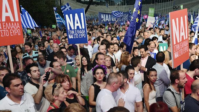 Pro-Europe supporters gather in front of Panathenian stadium during a 'YES' rally in Athens on July 3, 2015