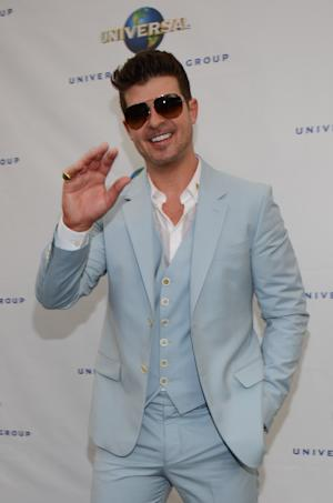 Robin Thicke seen at Universal Music Brunch to Celebrate the 56th Annual GRAMMY Awards, on Saturday, Jan. 25, 2014 in Hollywood, Calif. (Photo by Tonya Wise/Invision/AP)