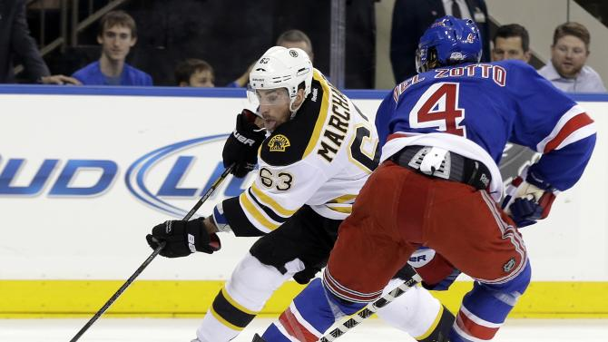 Boston Bruins' Brad Marchand (63) skates the puck against New York Rangers' Michael Del Zotto (4) during the first period in Game 3 of the Eastern Conference semifinals in the NHL hockey Stanley Cup playoffs Tuesday, May 21, 2013, in New York. (AP Photo/Seth Wenig)